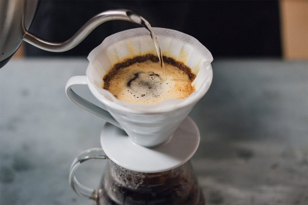 How to brew the perfect cup of pour-over coffee. Step 5 continue adding hot water to brew the coffee.